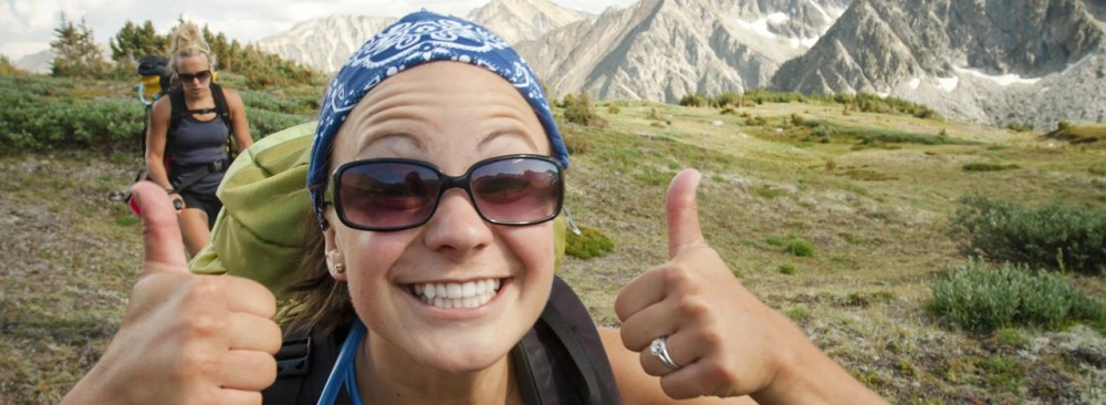 23-backpacker-thumbs-up-getty-182654419